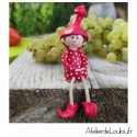 Lutin assis rouge
